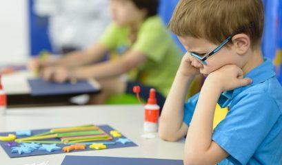 Angry,kid,looking,at,his,craft,at,kindergarten