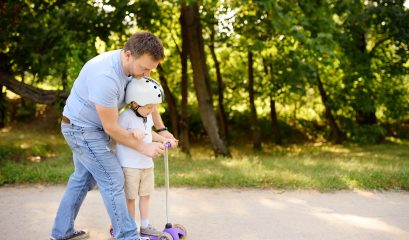 middle,age,father,showing,his,toddler,son,how,to,ride